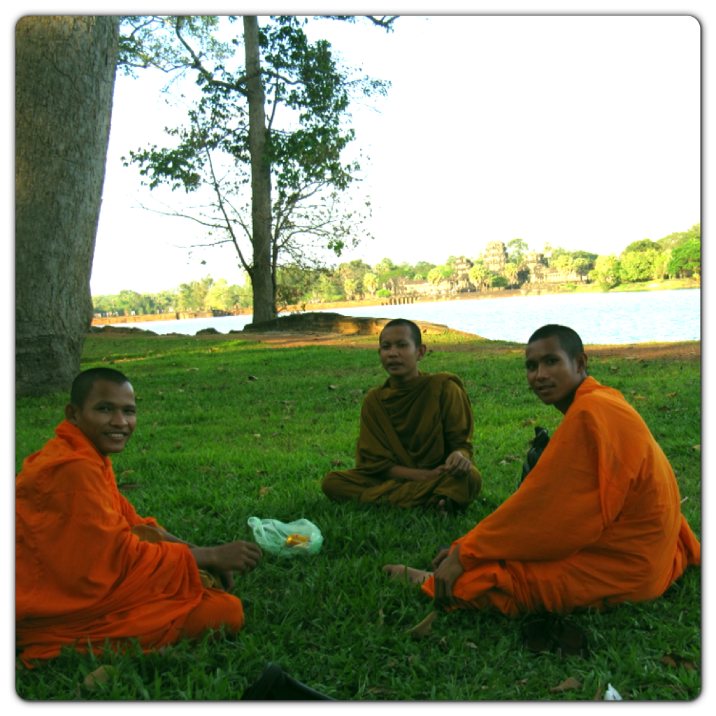 Buddhist monks having their afternoon snacks with the Angkor Wat as their spectacular backdrop